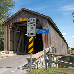 Lancaster, PA - June 9, 2012:  Hunsecker's Mill Covered Bridge is unpainted and crosses the Conestoga River in Lancaster County.