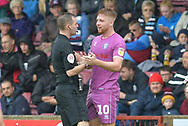 Rochdale midfielder Callum Camps (10)remonstrates with the ref during the EFL Sky Bet League 1 match between Scunthorpe United and Rochdale at Glanford Park, Scunthorpe, England on 8 September 2018. Photo Ian Lyall
