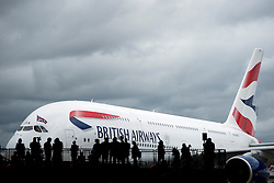 © London News Pictures. 04/07/2013 . London, UK.  Members of the media and British Airways staff watch as the new British Airways Boeing A380 superjumbo arrives at Heathrow Airport. It was the first time British Airlines have taken delivery of the new plane, making British Airways the first European airline to operate both the 787 and A380. Photo credit : Ben Cawthra/LNP