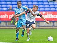 Bolton Wanderers midfielder Callum King-Harmes tackled by Coventry City defender Brandon Masonduring the EFL Sky Bet League 1 match between Bolton Wanderers and Coventry City at the University of  Bolton Stadium, Bolton, England on 10 August 2019.
