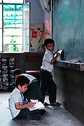 India, New Delhi, Majnu Ka Tila Tibetan refugee camp. Young students in a class room at the Tibetan school