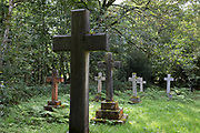 Stone crosses in the wild cemetery of St. Mark's Church on 13th September 2018, in Brithdir, near Dolgellau, Gwynedd, Wales.
