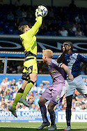 Jonathan Bond claims the ball ahead of Clayton Donaldson during the Sky Bet Championship match between Birmingham City and Reading at St Andrews, Birmingham, England on 8 August 2015. Photo by Alan Franklin.