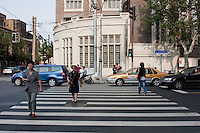 pedestrian crossing shanghai china with people and traffic