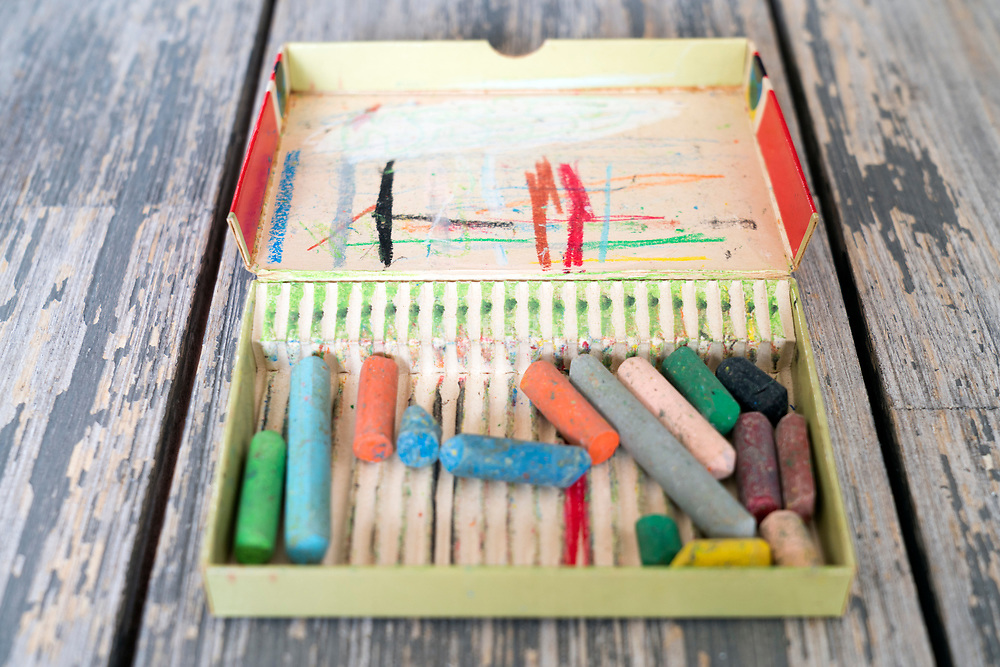 used chalk pastel crayons in a box  still life
