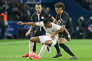 Manchester United Forward Marcus Rashford battles with Thilo Kehrer of Paris Saint-Germain and Dani Alves of Paris Saint-Germain during the Champions League Round of 16 2nd leg match between Paris Saint-Germain and Manchester United at Parc des Princes, Paris, France on 6 March 2019.