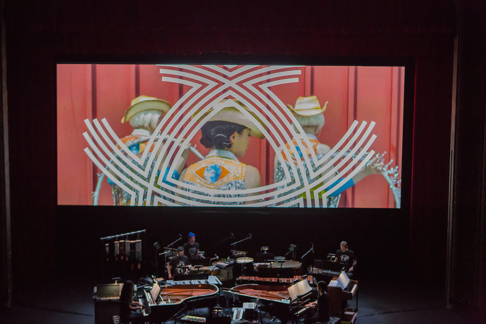 Brooklyn, NY - 20 January 2015. The dress rehearsal of Sufjan Stevens' Round-Up, with slow motion film of the Pendleton, Oregon Round-Up by Aaron and Alex Craig, music performd by Sufjan Stevens and Yarn/Wire. Musicians (L to R) Ning Yu (piano), Russell Greenberg, Sufjan Stevens (in the blue cap), Laura Barger (piano), Ian Antonio.