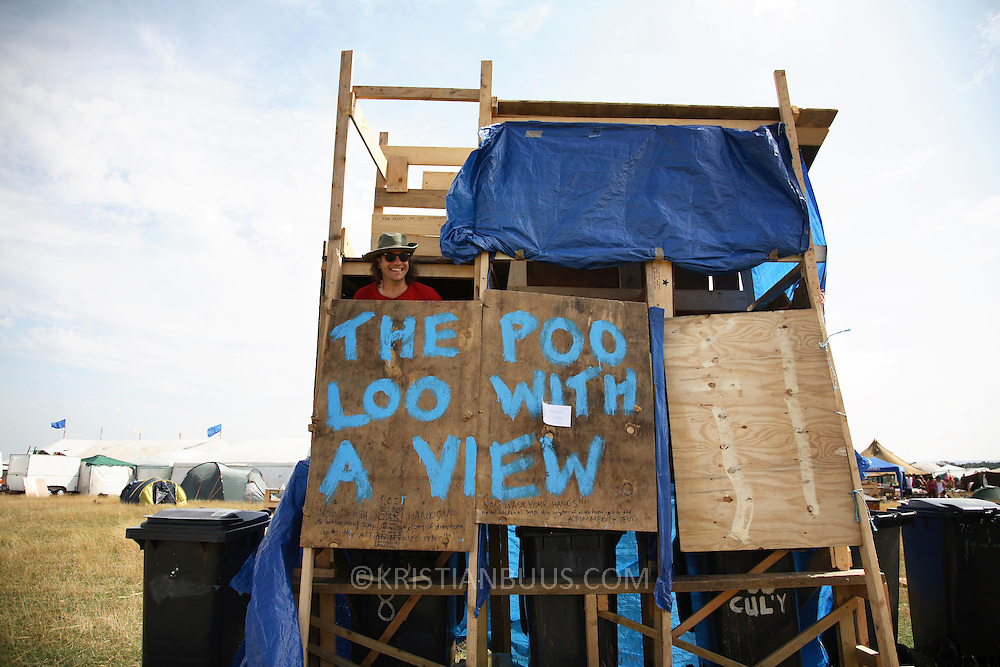 Climate Camp by Kingsnorth 2008.Camp for Climate Action is a movement made up of a lose network of people and environmental groups, wanting to stop climate change.  Through the Climate Camp they highlight issues such as aviation emission and CO2 emissions from coal power plants.  The Camp for Climate Camp wants to create a forum for people to discuss, learn and to act on climate change and to put pressure on the UK government to change its policies on polloting industries to make them commit to much more green policies. .The Climate Camp at Kingsnorth is the third camp running, previous years were by Heathrow, London and Drax coal power plant in Yorkshire. ..Living on the camp is as sustainable as possible, toilets are compost toilets where all human waste goes into wheelibins and taken away to used as manure.  This toilet is the one with the best view, over the fields.