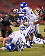 Kentucky Wildcats running back Dyshawn Mobley (33) is brought down by Arkansas Razorbacks defensive tackle Byran Jones (54) as Wildcat offensive guard Zach West (75) blocks and tight end Tyler Robinson (89) looks on during the second half of a game at Donald W. Reynolds Razorback Stadium in Fayetteville, Ark., on Oct.. 13, 2012. Photo by Beth Hall