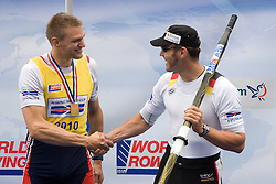 Winner Czech republic's Ondrej Synek  and third placed Germany's Marcel Hacker at medal ceremony in finish area after Men's Single Sculls  final A at Rowing World Cup  on May 30, 2010, at Bled's lake in Zaka, Bled, Slovenia. (Photo by Vid Ponikvar / Sportida)