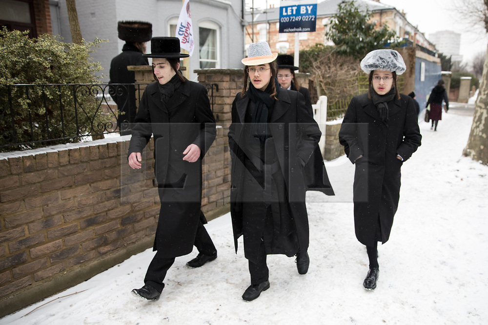 © Licensed to London News Pictures. 01/03/2018. London, UK. Orthodox Jews celebrate the festival of Purim in the streets of Stamford Hill in north London. Purim is celebrated by Jewish communities around the world with parades, parties in costume and the exchange of gifts. The event is documented in the Book of Esther, and commemorates the defeat of Haman, the advisor to the Persian king, and his plot to massacre the Jewish people 2,500 years ago. Photo credit : Tom Nicholson/LNP