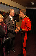 Reception to support the Hyde Park Appeal for Liberty Drives ( a charity which enables people to travel around Hyde Park in electric buggies) in the presence of Prince Michael of Kent. Officers Mess. Household Cavalry Mounted Regiment. Hyde Park Barracks. 30 November 2004. ONE TIME USE ONLY - DO NOT ARCHIVE  © Copyright Photograph by Dafydd Jones 66 Stockwell Park Rd. London SW9 0DA Tel 020 7733 0108 www.dafjones.com
