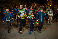 """People run on the 20th Korrika. Kadreita. (Basque Country). March 31, 2017. The """"Korrika"""" is a relay course, with a wooden baton that passes from hand to hand without interruption, organised every two years in a bid to promote the basque language. The Korrika runs over 11 days and 10 nights, crossing many Basque villages and cities. This year was the 20th edition and run more than 2500 Kilometres. Some people consider it an honour to carry the baton with the symbol of the Basques, """"buying"""" kilometres to support Basque language teaching. (Gari Garaialde / Bostok Photo)"""