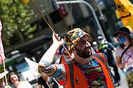 A protester holds his flag as if it is a medieval sword during an Extinction Rebellion protest in Melbourne.  A small group of climate protesters marched from Flagstaff Gardens to The Queen Victoria Market and ending with two individuals gluing themselves together, and then glued themselves to Victoria Avenue outside of the Market. This comes as 5 new COVID-19 cases were uncovered in Melbourne's revamped Hotel Quarantine, breaking almost 40 days of virus free days. (Photo by Dave Hewison/Speed Media)