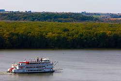 "October 2009:  Sightseeing paddle wheel boat ""Celebration Belle"" steams up the Mississippi River past Mississippi Palisades State Park. Sights to see in and around Galena Illinois."