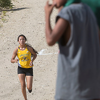 Valley Sanders junior Nizhoni James races for a second place finish of the Tohatchi Invitational Cross Country Meet at Hamburger Hill in Tohatchi, NM.