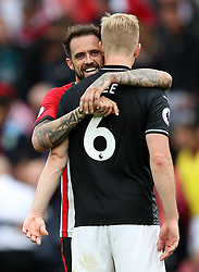 Southampton's Danny Ings (left) embraces former team-mate Burnley's Ben Mee after the Premier League match at St Mary's, Southampton.