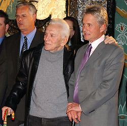 Kirk Douglas Dies At 103 - Kirk and Michael Douglas attend the ceremony as MPA Chairman and CEO Jack Valenti puts handprints and footprints in forecourt of Graumans Chinese Theatre in Hollywood, Los Angeles, CA, USA on December 6, 2004. Photo by Lionel Hahn/ABACA