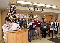 Lea Tassone reads the names of lost loved ones honored during the Celebration Reading at the Lakes Region General Hospital Auxilliary Tree of Love Services held Thursday afternoon. Fellow readers (l-r) James Rowe, Barbara Tuttle, Donald Lockwood, Joan Cormier and Colleen Hartigan.    (Karen Bobotas/for the Laconia Daily Sun)