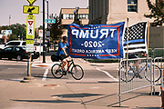 26 SEPTEMBER 2020 - DES MOINES, IOWA: Bicyclists ride past Donald Trump flags in downtown Des Moines. More than 1,500 people in 500 vehicles participated in motorcade through Des Moines Saturday. They started in the suburbs south of downtown, drove through downtown, and ended at the State Capitol.        PHOTO BY JACK KURTZ