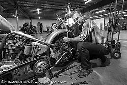 """Bill Buckingham working on his 1923 Harley-Davidson J model custom chopper (that won top honors at Born Free 6) on the Friday """"Rest Day"""" between stages 7 and 8 of the Motorcycle Cannonball Cross-Country Endurance Run in Junction City, KS., USA. Friday, September 12, 2014.  Photography ©2014 Michael Lichter."""
