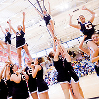 021213       Cable Hoover<br /> <br /> The Gallup High School cheerleading squad performs during the Bengals basketball game at Gallup High School Tuesday. The squad recently took first place in the Farmington Cheer and Dance Festival.