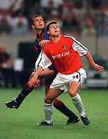 Tomas Danilevicius (Arsenal) and Philip Cocu (Barcelona). Arsenal v Barcelona. The Amsterdam Tournament. Amsterdam Arena, 3/8/2000. Credit: Colorsport / Stuart MacFarlane.