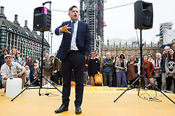 London, UK. 23rd April 2019. Jon Ashworth MP, Shadow Health Minister, addresses climate change activists from Extinction Rebellion at an assembly in Parliament Square prior to an attempt to deliver to Parliament activists' letters requesting meetings to discuss climate change with their Members of Parliament.