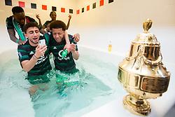 Bilal Basacikoglu of Feyenoord, Tonny Vilhena of Feyenoord, cup, trophy, dressing room, bath during the Dutch Toto KNVB Cup Final match between AZ Alkmaar and Feyenoord on April 22, 2018 at the Kuip stadium in Rotterdam, The Netherlands.