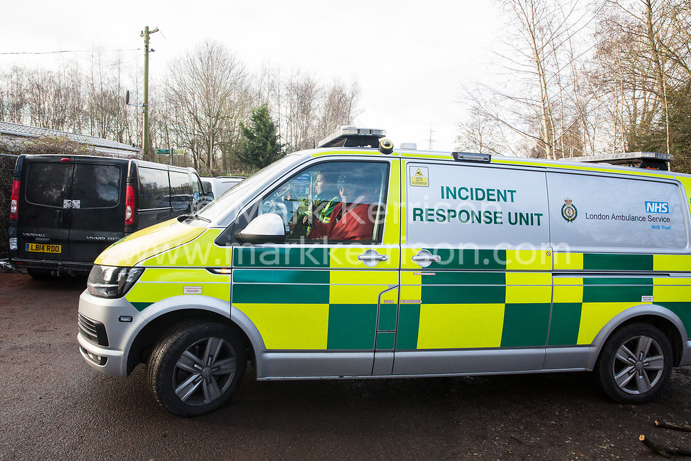 Harefield, UK. 16 January, 2020. Stop HS2 activist Freeman is taken away in a London Ambulance Incident Response Unit vehicle following his eviction from the Harvil Road wildlife protection camp in the Colne Valley after over two days and two nights taking refuge in a tree in woodland. 108 ancient woodlands are set to be destroyed by the high-speed rail link and further destruction of trees for HS2 in the Harvil Road area is believed to be imminent.