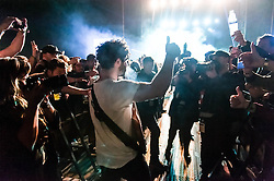 © Licensed to London News Pictures. 01/06/2014. Barcelona, Spain.   Foals performing live at Primavera Sound festival Day 4.   In this picture Yannis Philippakis dismounts the stage mid-set to walk greet the audience & exchanges thumbs-up with them.  Foals are an English indie rock band  consisting of members Yannis Philippakis (lead vocals, lead guitar), Jack Bevan (drums, percussion), Jimmy Smith (rhythm guitar rhodes, synthesizer, backing vocals), Walter Gervers (bass, sampler, percussion, backing vocals),Edwin Congreave (keyboards, synthesizer).  Primavera Sound, or simply Primavera, is an annual music festival that takes place in Barcelona, Spain in late May/June within the Parc del Fòrum leisure site. Photo credit : Richard Isaac/LNP