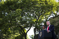 President Donald Trump delivers remarks during a ceremony in the Rose Garden of the White House to present the Presidential Medal of Freedom to Tiger Woods on May 6, 2019 in Washington, DC. (Photo by Oliver Contreras/SIPA USA)