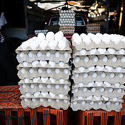 Stacks of fresh eggs on crates for sale at the main market in Antigua, Guatemala.