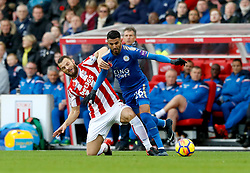 Stoke City's Erik Pieters (left) and Leicester City's Riyad Mahrez battle for the ball