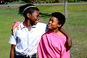 African Am. 13 year old friends with arms around shoulders.  Minneapolis Minnesota USA