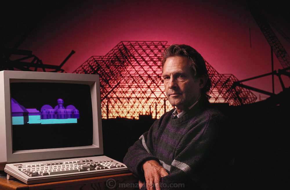 USA_SCI_BIOSPH_81_xs <br /> Biosphere 2 Project undertaken by Space Biosphere Ventures, a private ecological research firm funded by Edward P. Bass of Texas.  Architect Philip Hawes at a computer workstation, with Biosphere construction on his computer and projected onto the background.  Biosphere 2 was a privately funded experiment, designed to investigate the way in which humans interact with a small self-sufficient ecological environment, and to look at possibilities for future planetary colonization. The $30 million Biosphere covers 2.5 acres near Tucson, Arizona, and was entirely self- contained. The eight 'Biospherian's' shared their air- and water-tight world with 3,800 species of plant and animal life. The project had problems with oxygen levels and food supply, and has been criticized over its scientific validity. 1990