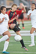 Kaylee Bewer of the Victoria East Lady Titans (right) and Jocelyn Sanchez of the C.C. Winn Mavericks struggle for the ball during their game in Floresville. Photo:Jaime R. Carrero/jcarrero@vicad.com