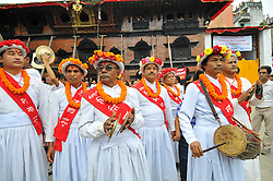 September 15, 2016 - Kathmandu, Nepal - Priest on a traditional attire playing traditional drums attending on the third day of Indra Jatra Festival celebrated at Basantapur Durbar Square, Kathmandu. Devotees celebrated the god of rain 'Indra' for 8 days in Kathmandu. (Credit Image: © Narayan Maharjan/Pacific Press via ZUMA Wire)