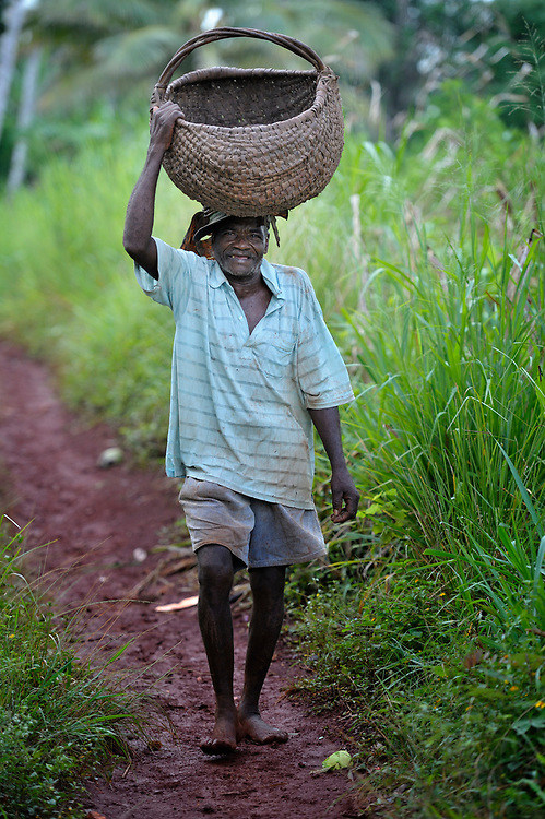A man walks along a path in the rural Haitian village of Mizak, where the United Methodist Committee on Relief (UMCOR) is helping farmers battle hunger by improving their agricultural practices.