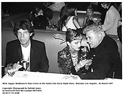 Mick Jagger, Madonna & Tony Curtis at the Vanity Fair Oscar Night Party.  Mortons. Los Angeles.  24 March 1997<br />Copyright Photograph by Dafydd Jones<br />66 Stockwell Park Rd. London SW9 0DA<br />Tel 0171 733 0108