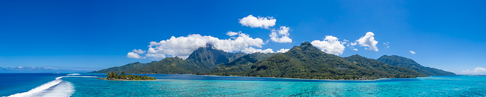 An aerial view of Moorea, French Polynesia, surrounded by the clear waters of the  tropical South Pacific Ocean