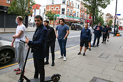 © Licensed to London News Pictures. 04/07/2020. London, UK. Customers queue outside MESSY CUT barbers on Green Lanes in Harringay, north London as hairdressers  reopen on Super Saturday. Cafes, restaurants, pubs and hairdressers across the UK closed on 23 March following the coronavirus lockdown. As restrictions are eased, cafes, restaurants, pubs and hairdressers reopens today. Photo credit: Dinendra Haria/LNP