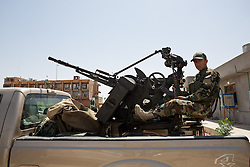 © Licensed to London News Pictures. 30/06/2014. Khanaqin, UK Khanaqin, Iraq. A Kurdish peshmerga soldier mans a twin 14.5mm NSV heavy machine gun at a Kurdish peshmerga base in Khanaqin, Iraq, as fighters prepare to head out and relieve troops at the front line in Jalawla. Counted by Kurds as part of their homeland, fighting in the town of Jalawla now consists of occasional skirmishes and exchanges of fire between snipers and heavy machine guns on both sides.<br /> <br /> The peshmerga, roughly translated as those who fight, is at present engaged in fighting ISIS all along the borders of the relatively safe semi-automatous province of Iraqi-Kurdistan. Though a well organised and experienced fighting force they are currently facing ISIS insurgents armed with superior armament taken from the Iraqi Army after they retreated on several fronts. Photo credit : Matt Cetti-Roberts/LNP