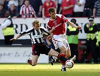Photo: Olly Greenwood.<br />Charlton Athletic v Sheffield United. The Barclays Premiership. 21/04/2007. Sheffield United's  Derek Geary tackles Charlton's Hermann Hreidarsson