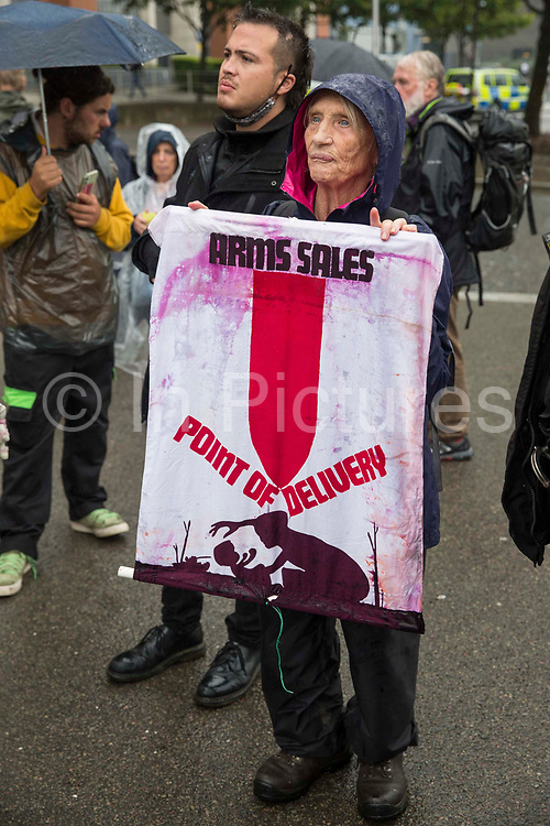 Quaker Sylvia Boyes, a former Greenham Common peace campaigner, blocks the road outside ExCeL London on the first day of the DSEI 2021 arms fair on 14th September 2021 in London, United Kingdom. Activists from a range of different groups have been protesting outside the venue for one of the worlds largest arms fairs for over a week.
