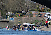 Mortlake/Chiswick, GREATER LONDON. United Kingdom. Crew coming ashore at Mortlake Anglian and Alpha and Quintin BC  foreshore, after completing the 2017 Vesta Veterans Head of the River Race, The Championship Course, Putney to Mortlake on the River Thames.<br /> <br /> <br /> Sunday  26/03/2017<br /> <br /> [Mandatory Credit; Peter SPURRIER/Intersport Images]