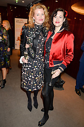 Left to right, ERIN MORRIS and JASMINE GUINNESS at a ladies lunch in aid of the charity Child Bereavement UK held at The Bulgari Hotel, 171 Knightsbridge, London on 25th February 2016.