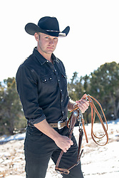 cowboy holding reins outdoors