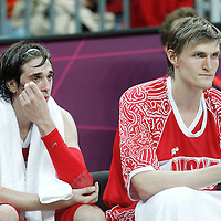 31 July 2012: Russia Alexey Shved seats on the bench next to Andrei Kirilenko during the 73-54 Russia victory over China, during the men's basketball preliminary, at the Basketball Arena, in London, Great Britain.