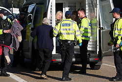 Ockham, UK. 21st September, 2021. Insulate Britain climate activist Reverend Sue Parfitt is arrested by Surrey Police after blocking the clockwise carriageway of the M25 between Junctions 9 and 10 as part of a campaign intended to push the UK government to make significant legislative change to start lowering emissions. Both carriageways were briefly blocked before being cleared by Surrey Police. The activists are demanding that the government immediately promises both to fully fund and ensure the insulation of all social housing in Britain by 2025 and to produce within four months a legally binding national plan to fully fund and ensure the full low-energy and low-carbon whole-house retrofit, with no externalised costs, of all homes in Britain by 2030.